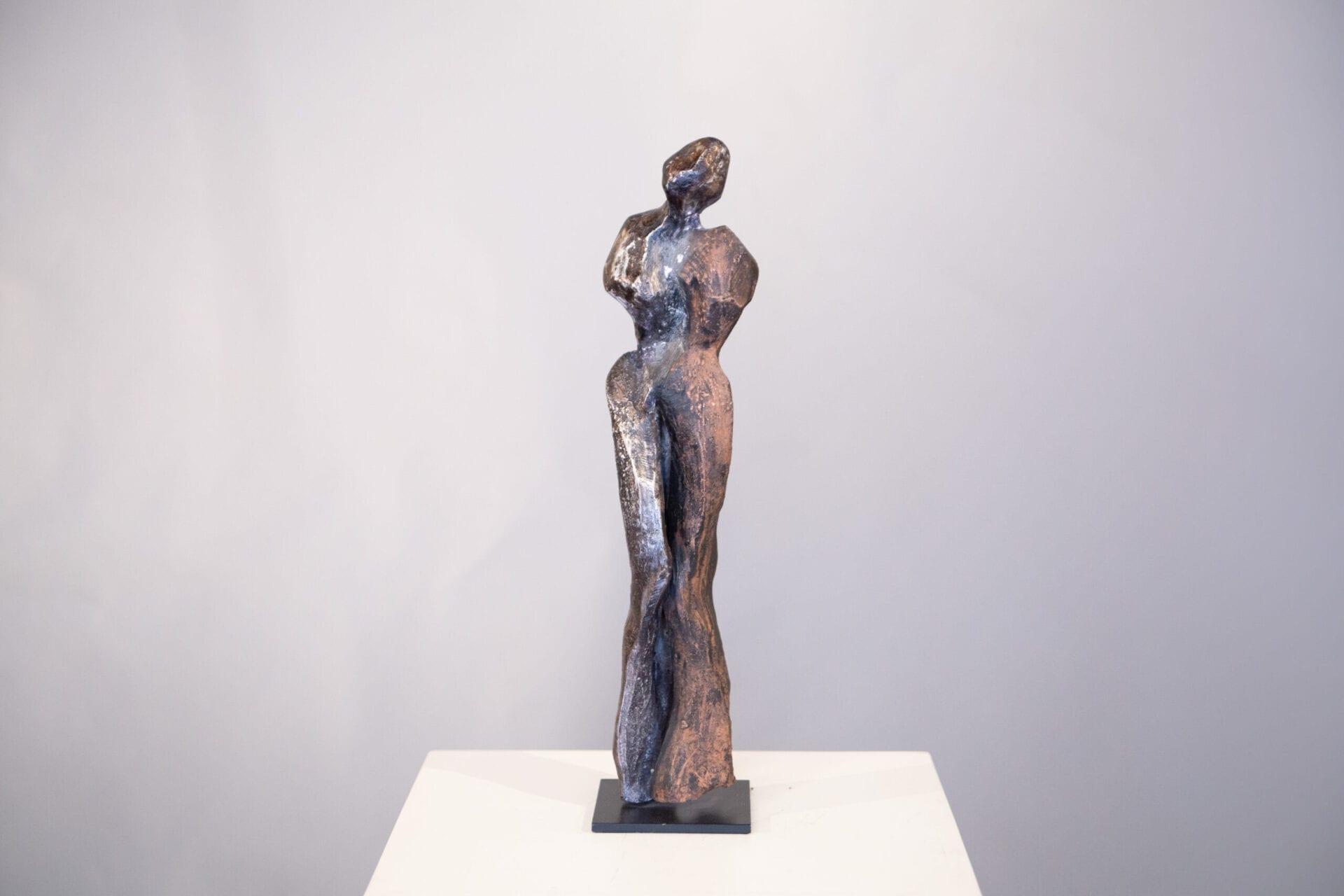 "Material Connection II   Sheila Ganch   Stoneware/Bronze   19 x 4 x 4"""